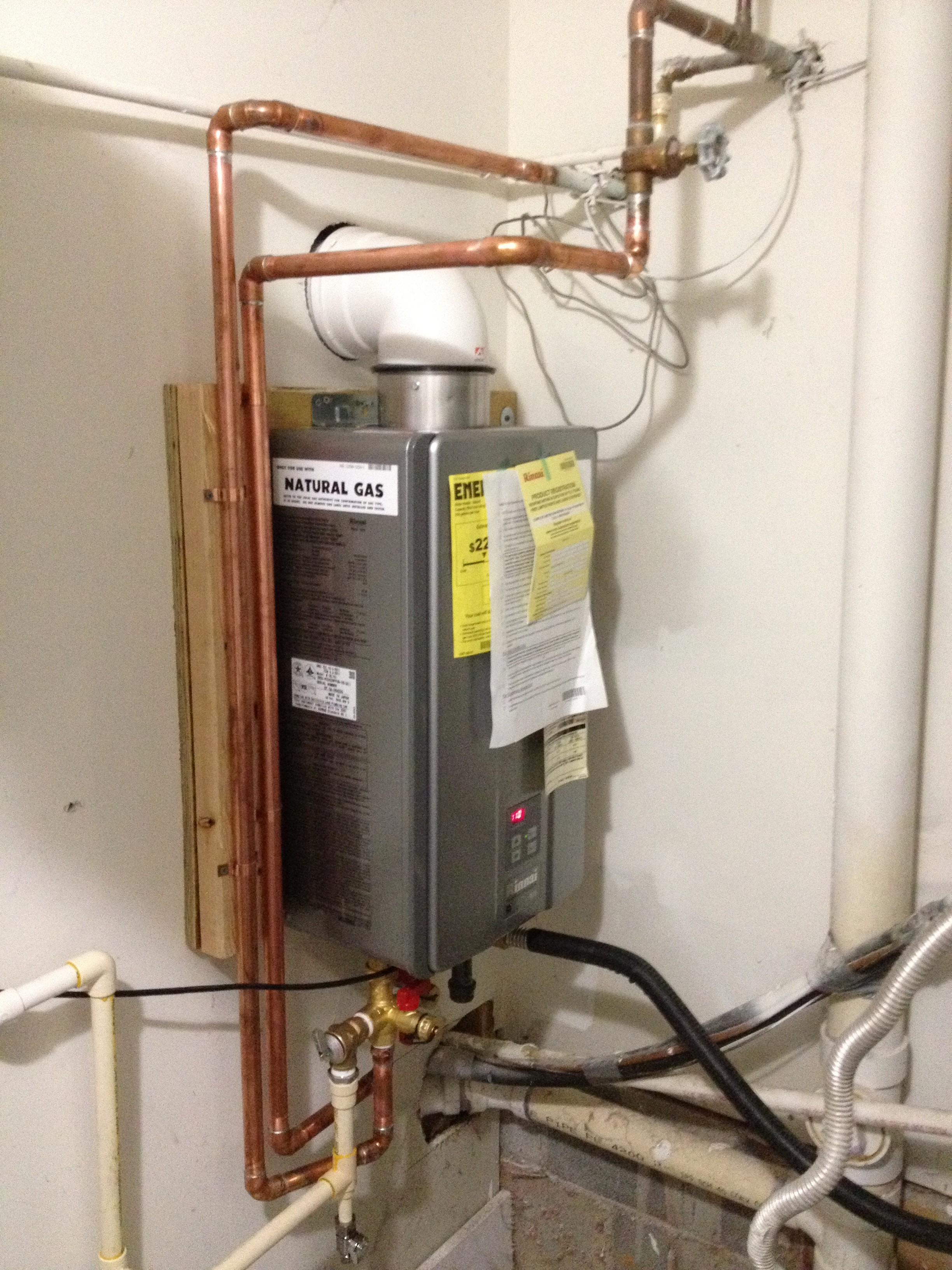 Water Service Installation : Tankless with storage tank and circulation pump tom kris